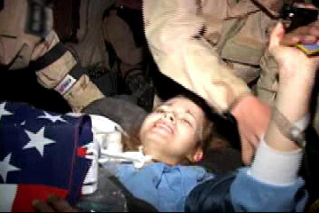 US Army (USA) Private First Class (PFC) Jessica D. Lynch, 507th Ordnance Maintenance Company, is returned to US Military custody following a daring rescue mission by US Special Forces, from a hospital in Nassiriya, Iraq, during Operation IRAQI FREEDOM. (VIDEO FRAME CAPTURE)