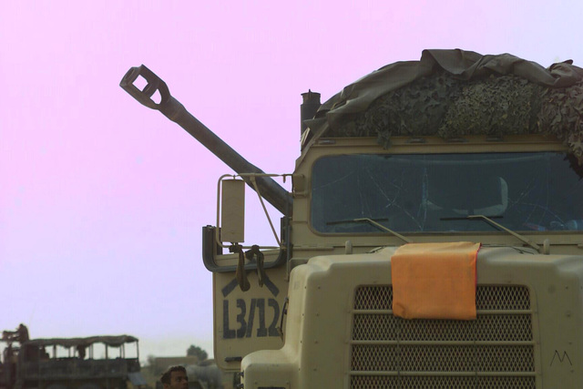 A US Marine Corps (USMC) Medium Tactical Vehicle Replacement (MTVR) 7.1 ton truck from Lima Battery 3/11 suffered windshield damage due to the percussion from a M198 Towed Field Howitzer 25 minute long fire mission, in support of Operation IRAQI FREEDOM
