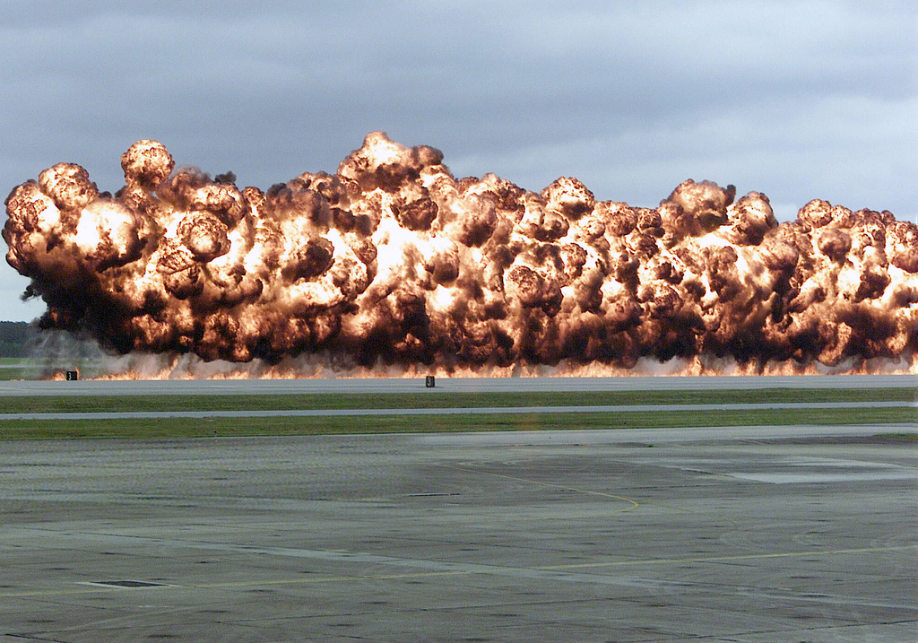 Fire and smoke rises as a simulated napalm explosion is set off on the flight line during an air show demonstration at Marine Corps Air Station (MCAS) Cherry Point, North Carolina (NC)