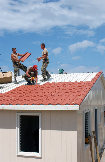 US Air Force (USAF) Civil Engineers (CE) with the 820th Red Horse Squadron (RHS), install new roof tiles at the Saint Paul's Health Center construction site during Exercise New Horizons, on the island of St. Kitts.  New Horizons is a US Southern Command (USSOUTHCOM) combined field-training exercise (FTX)