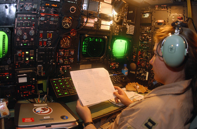 US Air Force (USAF) B-52 Stratofortress Bomber Navigator, Captain (CAPT) Michelle Gillespie, assigned to the 40th Expeditionary Bomb Squadron (EBS), checks winds over the target area during a mission over Iraq, in support of Operation IRAQI FREEDOM