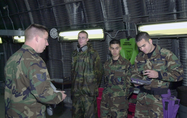 US Air Force (USAF) Technical Sergeant (TSGT) David McBride, left, with the 31st Maintenance Group (MXG), Weapons Standardization Flight (WSF), gives the 510th Fighter Squadron (FS), competition team a briefing on what is expected of them