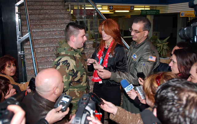 While on location in Bulgaria, actress and model Angie Everhart is surrounded by local media, during her visit to meet and show her support for the US Air Force (USAF) Airmen deployed to Camp Sarafovo, Bulgaria, in support of Operation IRAQI FREEDOM