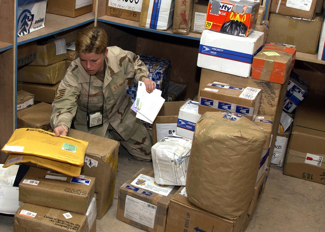Everyday at the 379th Expeditionary Communications Squadron (ECS) Post Office, US Air Force (USAF) personnel unload, sort and deliver two five-ton trucks filled with incoming mail for the troops of this forward-deployed air base, in support of Operation IRAQI FREEDOM