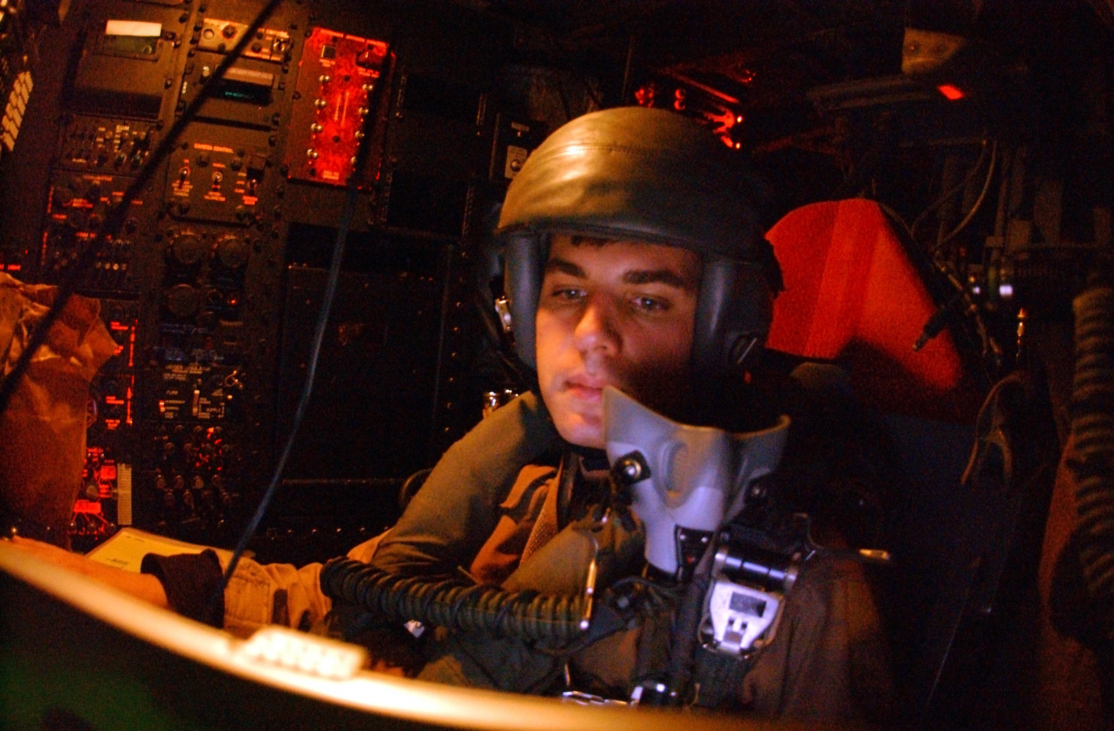 Over Iraqi skies, US Air Force (USAF) Navigator, Captain (CAPT) Edward Gussman, plots a post bombing egress for the 40th Expeditionary Bomb Squadrons (EBS) formation of B-52 Stratofortress Bombers, as they move towards a target, in support of Operation IRAQI FREEDOM
