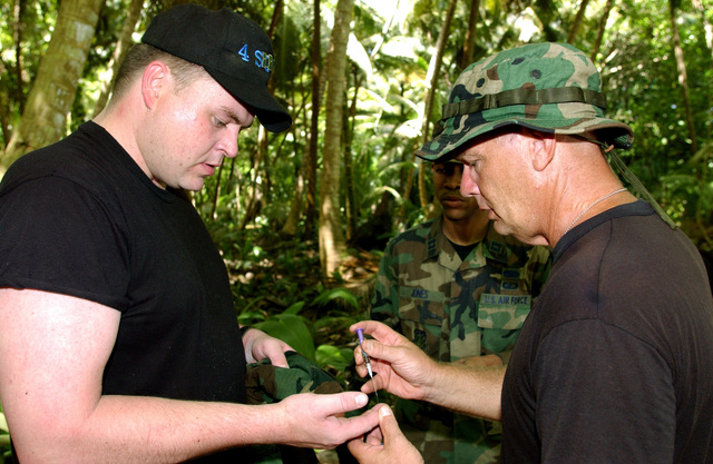 US Air Force (USAF) Captain (CAPT) Mark Greenway, from Detachment 2, receives a Benadryl shot for bee stings he received during a Search and Rescue Mission, that ended with finding a missing 65-year-old contractor in a densely wooded area near Camp Justice, during Operation IRAQI FREEDOM