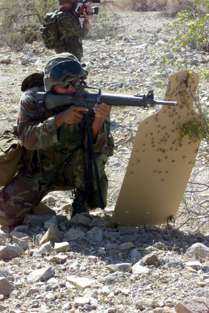Lance Corporal (LCPL) Beatty, Charlie Company 1ST Battalion 6th Marines, positions himself behind a target for cover during a training raid, at the Barry M. Goldwater Range, at Marine Corps Air Station (MCAS) Yuma, Arizona
