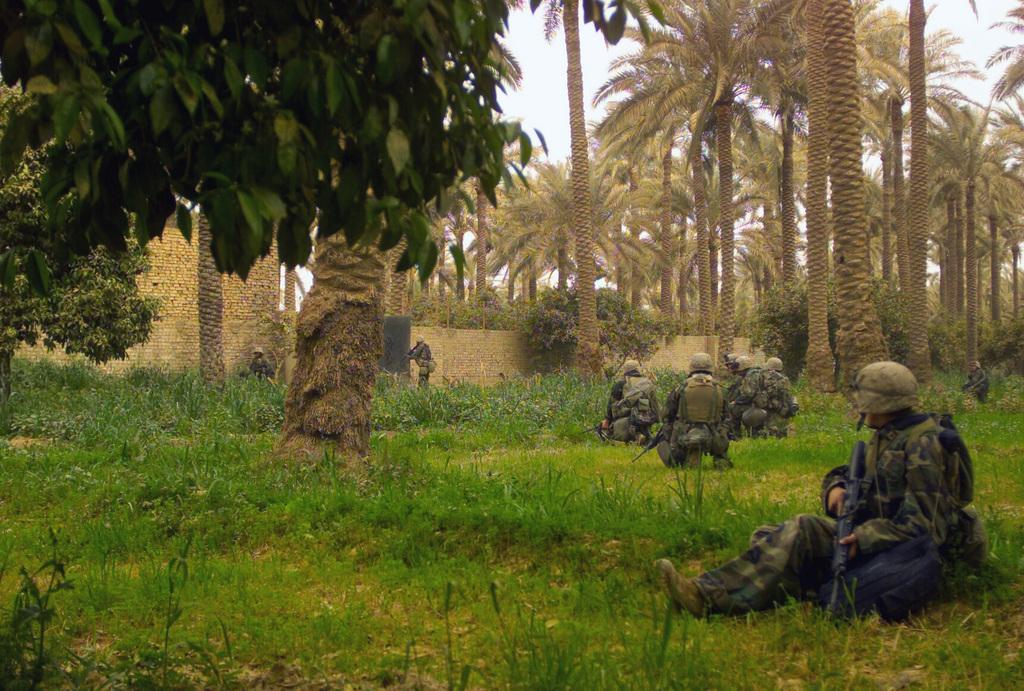 US Marines Corps (USMC) Marines, 1ST Battalion, 7th Marines (1/7), Charlie Company, Twentynine Palms, California (CA), on patrol outside the city of Qa dawi, Baghdad during of Operation IRAQI FREEDOM