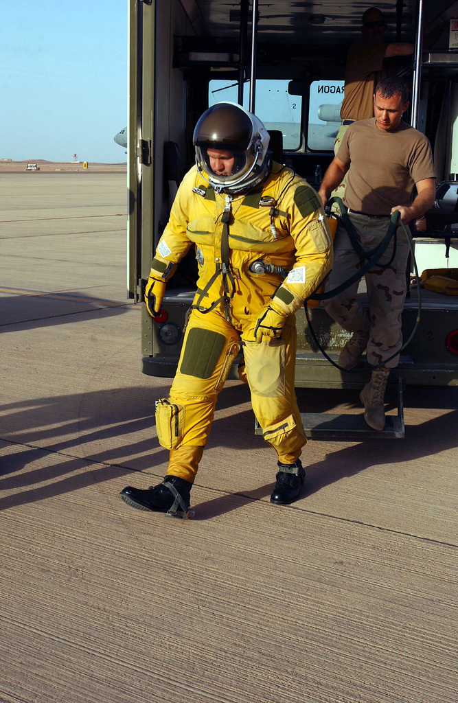 US Air Force (USAF) Lieutenant Colonel (LTC) Walter Flint, a deployed U-2 Dragon Lady aircraft Commander from the 99th Reconnaissance Squadron, serving with the 363rd Expeditionary Reconnaissance Squadron (ERS), exits a crew bus in his 1034 pressure flight suite, after arriving on the flight line at an undisclosed location in Southwest Asia, during Operation IRAQI FREEDOM