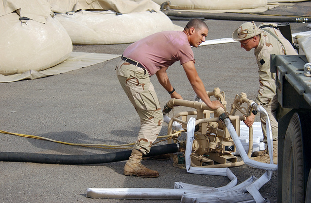 US Army (USA) Soldiers assigned to the 79th Quartermaster Company operate a water storage and distribution center at the port of Umm Qasr, Iraq, during Operation IRAQI FREEDOM