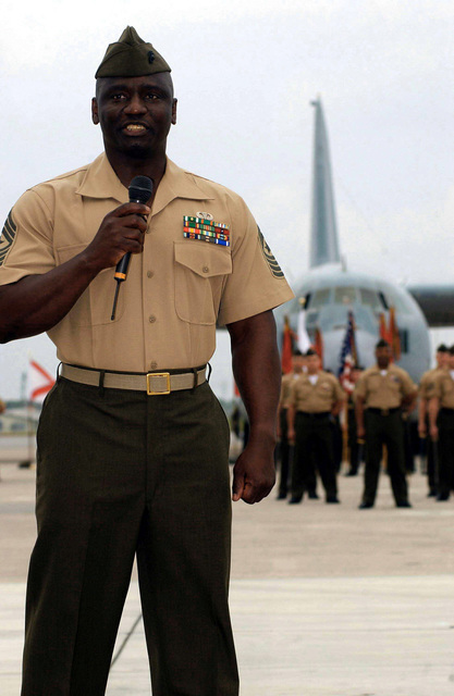 With a KC-130 Hercules as a backdrop, members of the Marine Aircraft Group-36 (MAG-36) stand in formation as they listen to Sergeant Major (SGTMAJ) Frankie Holmes, USMC, (left), oncoming MAG-36 Sergeant Major, thanks the outgoing Sergeant Major and his family for their hospitality and tell a little about himself. The post and relief ceremony took place at Marine Corps Air Station (MCAS) Futenma, Okinawa, Japan