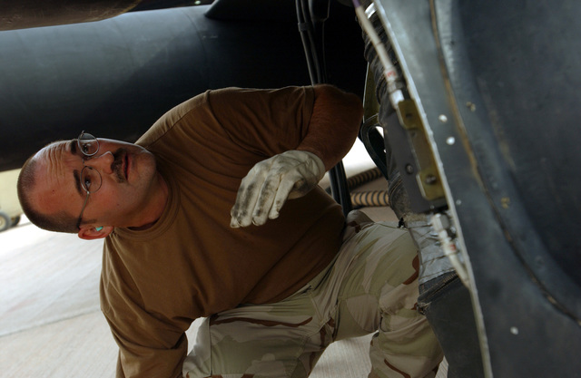 US Air Force (USAF) MASTER Sergeant (MSGT) Michael Rac, Production Superintendent, deployed from 9th Maintenance Squadron (MXS), to the 363rd Expeditionary Aircraft Maintenance Squadron (EAMXS), performs a preflight inspection on a U-2R Dragon Lady aircraft, at a forward deployed location in Southwest Asia, during Operation IRAQI FREEDOM