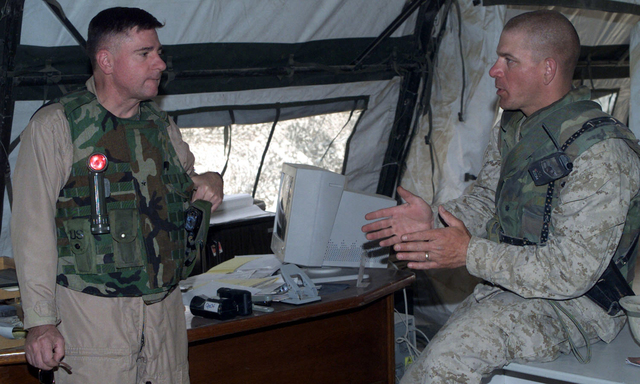 US Marine Corps (USMC) General (GEN) Terry G. Roblin, left, visits with the assistant Wing Commander of Marine Wing Support Squadron-271 (MWSS-271) Lieutenant Colonel (LCOL) Alan L. Thoma, at Three Rivers, Iraq, in support of Operation IRAQI FREEDOM