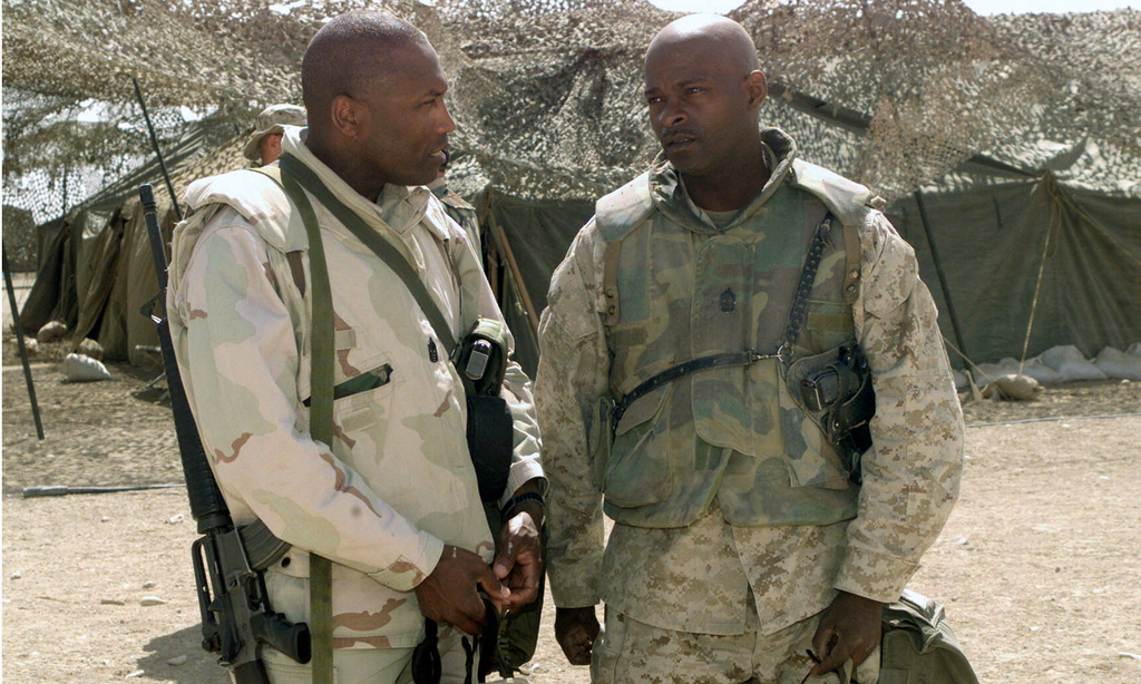 US Marine Corps (USMC) Sergeant Major (SGMAJ) John L. Estrada, left, visits with Marine Wing Support Squadron-271 (MWSS-271) SGMAJ Robert Roberts, in Three Rivers, Iraq, in support of Operation IRAQI FREEDOM