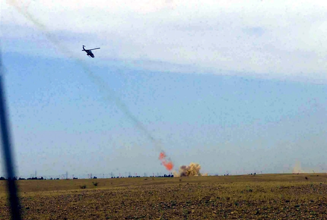 A US Marine Corps (USMC) AH-1W Super Cobra helicopter engages an enemy anti-aircraft gun position with AGM-114 Hellfire Missiles, while providing close air support for Delta/Company, 1ST Light Armored Reconnaissance Battalion, 1ST Marine Division, in Northern Iraq, during Operation IRAQI FREEDOM. (Substandard image)