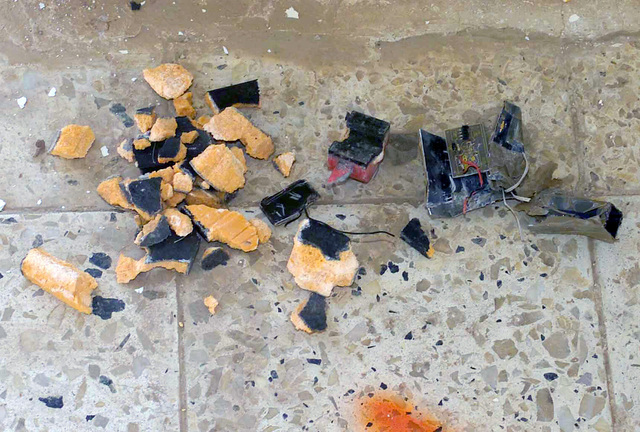Explosives and detonator for a suicide briefcase armed to detonate is discovered in a school in Baghdad school during Operation IRAQI FREEDOM