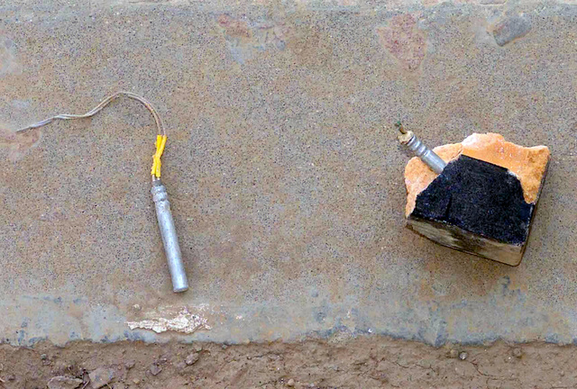 Explosives and detonator for a suicide briefcase is discovered in a school in Baghdad school during Operation IRAQI FREEDOM