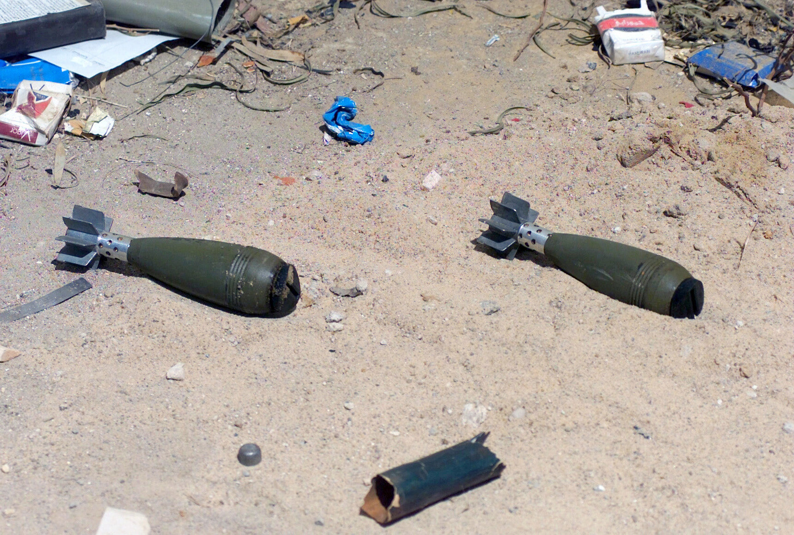Two Iraqi 82mm mortar rounds lay in an El Fedayeen