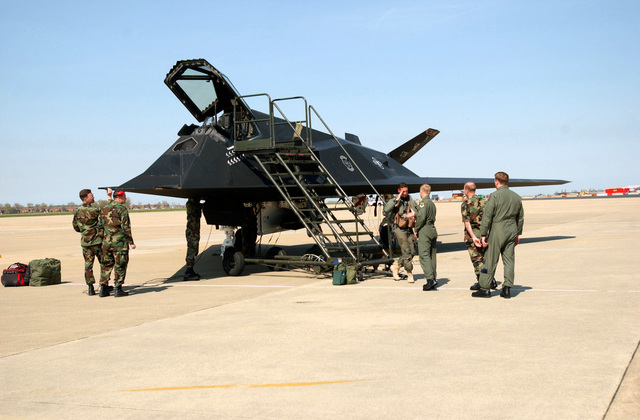 US Air Force (USAF) Colonel (COL) Steve Miller, Commander, 1ST Fighter Wing (FW), Langley Air Force Base (AFB), Virginia (VA), and members of his staff are on hand to greet US Air Force (USAF) F-117A Nighthawk stealth fighter aircraft from the 49th Fighter Wing (FW), Holloman AFB, New Mexico (NM), during a scheduled stopover at Langley, as the aircraft are enroute to their home base following a deployment to Iraq, supporting Operation IRAQI FREEDOM