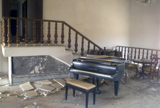 A mini grand piano and stool stands open in one of Saddam Husseins palaces in downtown Baghdad during Operation IRAQI FREEDOM