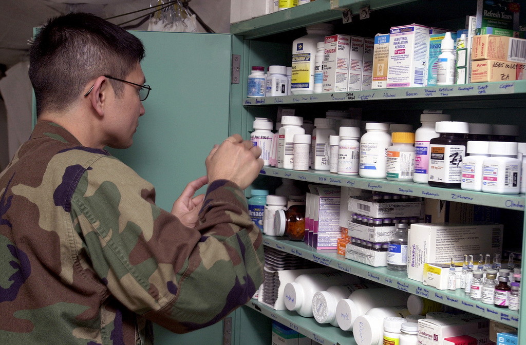 US Air Force (USAF) Captain (CAPT) Jay Alota, Clinical Nurse, Sembach, Germany, arranges medical supplies in the clinic at Mihail Kogalniceanu Air Base (AB), Romania, during Operation IRAQI FREEDOM