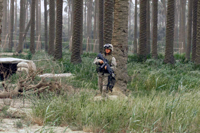 US Marine Corps (USMC) personnel from Charlie Company, 3rd Battalion, 7th Marines on a security patrol in and around Baghdad, Iraq, in support of Operation IRAQI FREEDOM