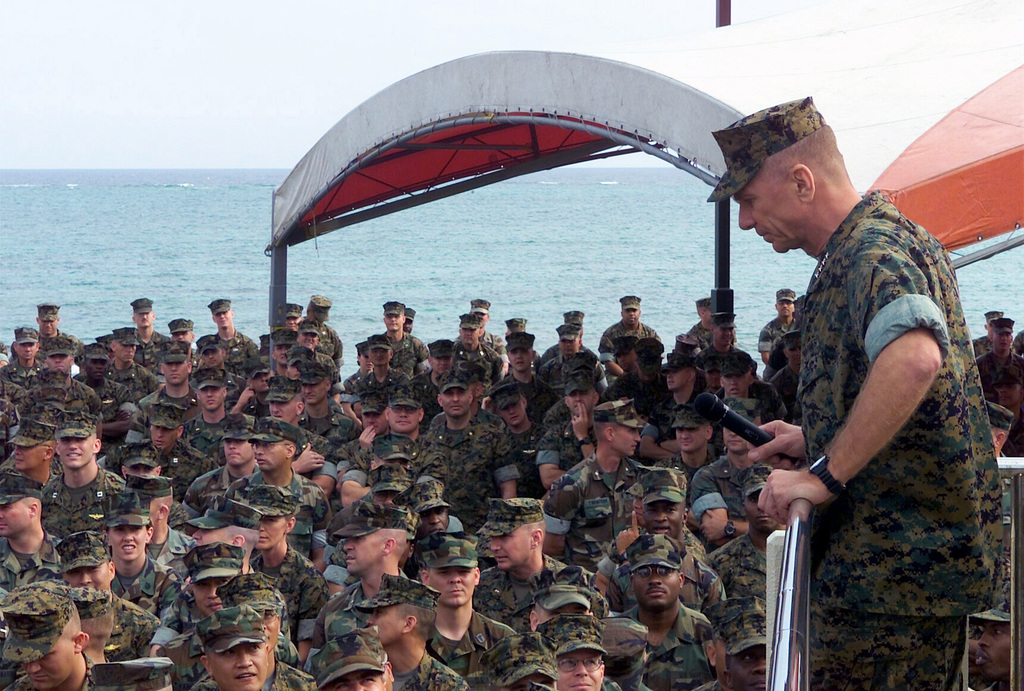 General (GEN) Michael W. Hagee, (right), Commandant of the Marine Corps (CMC), listens to a question from a Marine during a visit with a gathering of III Marine Expeditionary Force (MEF) Marines at the Beachhead, an enlisted club located on Camp Schwab, Okinawa. GEN Hagee visited III MEF for the first time as the CMC, during his visit he will tour Marine bases located on Okinawa, Japan