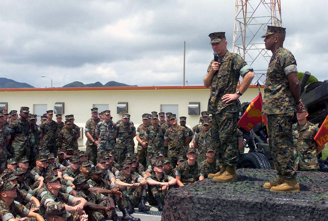 General (GEN) Michael W. Hagee, (standing left), Commandant of the Marine Corps (CMC), and Sergeant Major of the Marine Corps Alford McMichael, (standing right), visit with the 12th Marines at gun park. GEN Hagee visited III Marine Expeditionary Force (MEF) for the first time as the CMC. During his visit he will tour Marine bases located on Okinawa, Japan