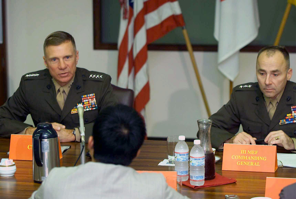 """General (GEN) Michael W. Hagee, (left), Commandant of the Marine Corps (CMC), and Lieutenant General (LGEN) Wallace C. """"Chip"""" Gregson, Commanding General, III Marine Expeditionary Force (MEF); Commander, Marine Corps Bases, Japan; Commander, Marine Forces, Japan, sit in a meeting with the Japanese press. The press meeting held as part of a visit by GEN Hagee, to the III MEF for the first time as the CMC"""