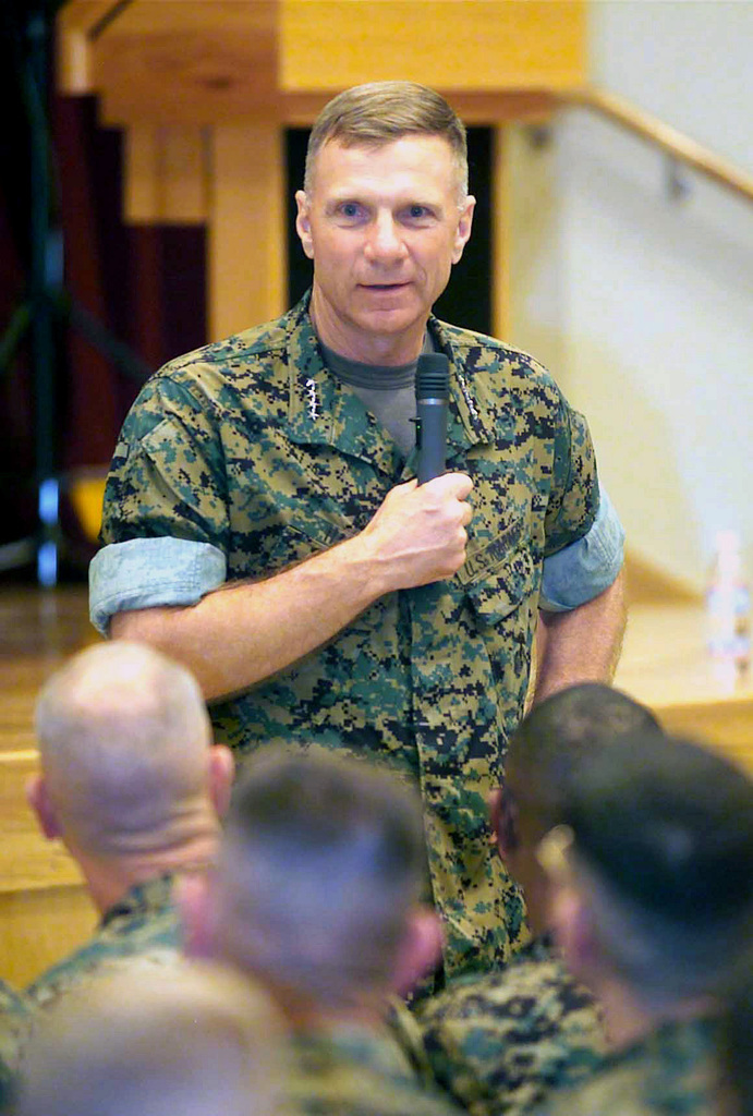 General (GEN) Michael W. Hagee, (left), Commandant of the Marine Corps (CMC), visits the community center located on Camp Foster, and speaks to senior staff members about issues that they can work out here in Okinawa
