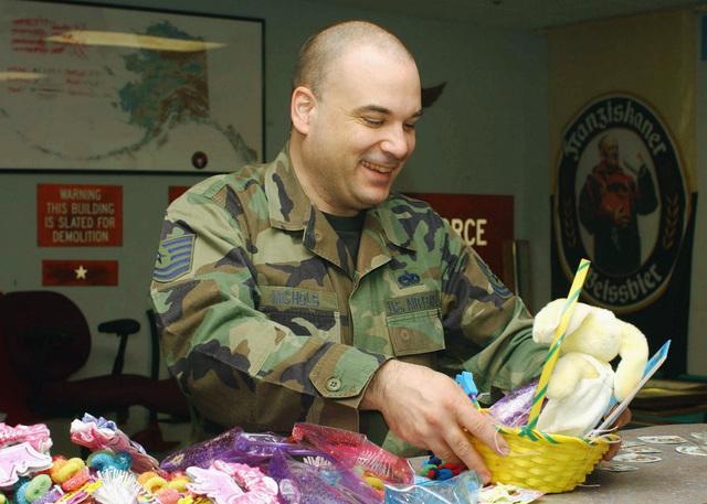 US Air Force (USAF) Technical Sergeant (TSGT) Michael Nichols, 703rd Aircraft Maintenance Squadron (AMXS), Elmendorf Air Force Base (AFB), Alaska (AK), makes Easter baskets for children at the local hospitals