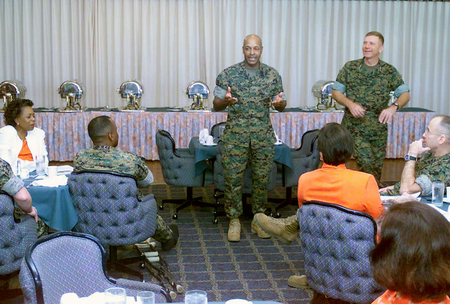 General (GEN) Michael W. Hagee, (right), Commandant of the Marine Corps (CMC), and Sergeant Major of the Marine Corps (SMMC) Alford McMichael, (center), give impromptu speeches at their going away breakfast at Chesty's SENIOR Non-Commissioned Officers (SNCO) club. GEN Hagee visited III MEF for the first time as the CMC, during his visit he toured the bases located on Okinawa, Japan