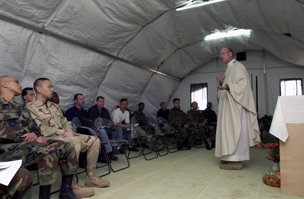 US Air Force (USAF) Major (MAJ) Linn Harbour, Catholic Chaplain, Maxwell Air Force Base (AFB), Alabama (AL), speaks to the congregation about the meaning of Easter and of sacrifice during the Easter Sunday Mass at Mihail Kogalniceanu Air Base (AB), Romania, during Operation IRAQI FREEDOM