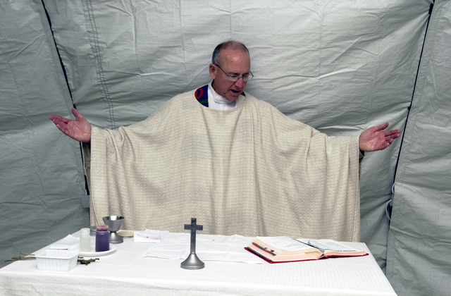 US Air Force (USAF) Major (MAJ) Linn Harbour, Catholic Chaplain, Maxwell Air Force Base (AFB), Alabama (AL), leads the Easter Sunday Mass at Mihail Kogalniceanu Air Base (AB), Romania, during Operation IRAQI FREEDOM