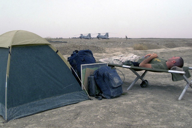 US Marine Corps (USMC) Captain (CPT) Dan J. McSweeney, Officer-in-Charge, Public Affairs/Combat Camera, 24th Marine Expeditionary Unit (MEU) Special Operations Capable (SOC), takes a nap on a cot at Camp Fenway, Iraq, during Operation IRAQI FREEDOM