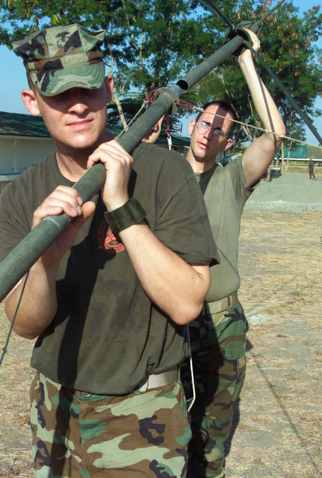 US Marine Corps (USMC) Computer Specialists Lance Corporal (LCPL) Mike C. Hill, foreground and Lance Corporal (CPL) Andew J. Busch, with the 2nd Battalion, 7th Marines, install an antenna for communications during Exercise BALIKATAN 2003