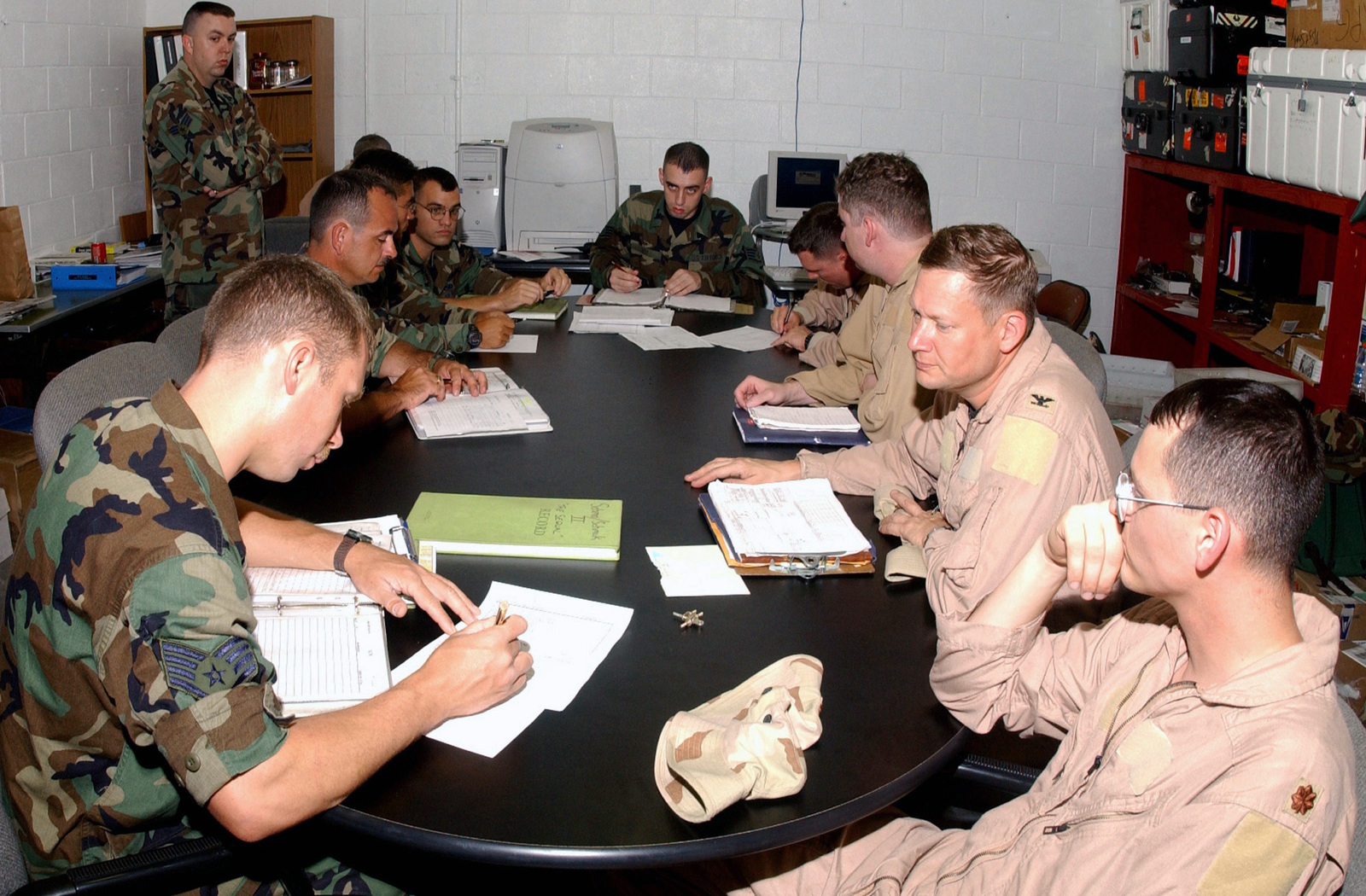 US Air Force (USAF) Colonel (COL) George Gagnon, Navigator, 40th Expeditionary Bomb Squadron (EBS), (second from right) and his crew debrief members of the 40th Expeditionary Maintenance Squadron (EMS) following a successful B-52 Stratofortress close air support mission (CAS) over Iraq during Operation IRAQI FREEDOM