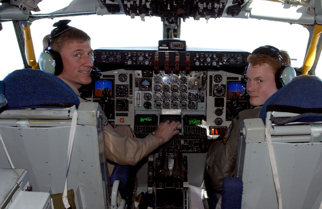 US Air Force (USAF) Colonel (COL) Tony Mauer (left) and USAF First Lieutenant (1LT) Eric Adcock fly a KC-135 Stratotanker as they prepare to refuel both their brother's aircraft. COL Mauer's brother, USAF Major (MAJ) John Mauer, is the navigator a USAF AWACS and 1LT Adcock's brother, 1LT Nick Adcock, is a co-pilot in the E-8C Joint STARS aircraft