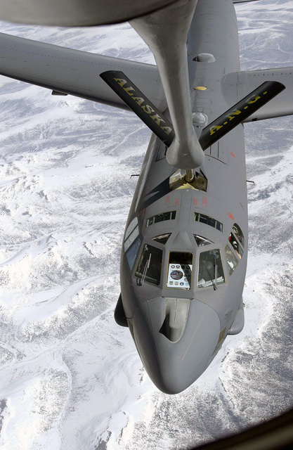A US Air Force (USAF) B-52H Stratofortress receives fuel from a KC-135 Stratotanker assigned to the 168th Air Refueling Wing (ARW), high over Alaska during a 16-hour Avionics Midlife Improvement (AMI) test flight directed by 419th Flight Test Squadron (FTS) officials