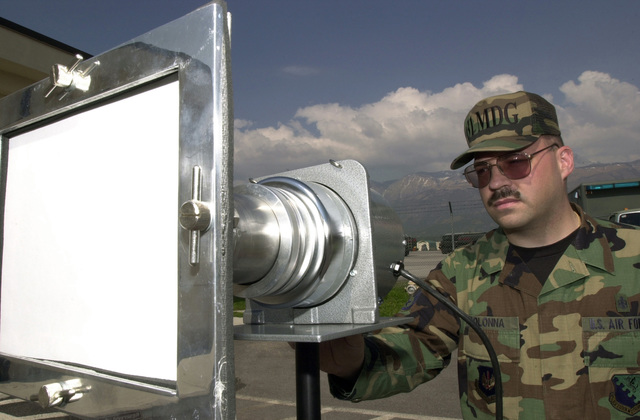 US Air Force (USAF) STAFF Sergeant (SSGT) Matthew Colonna, Bioenvironmental Technician, 31st Aerospace Medical Squadron (AMS), 31st Medical Group (MDG), uses a Staplex TFIA High Volume Air Sampler to detect alpha radiation when testing special Air Force assets
