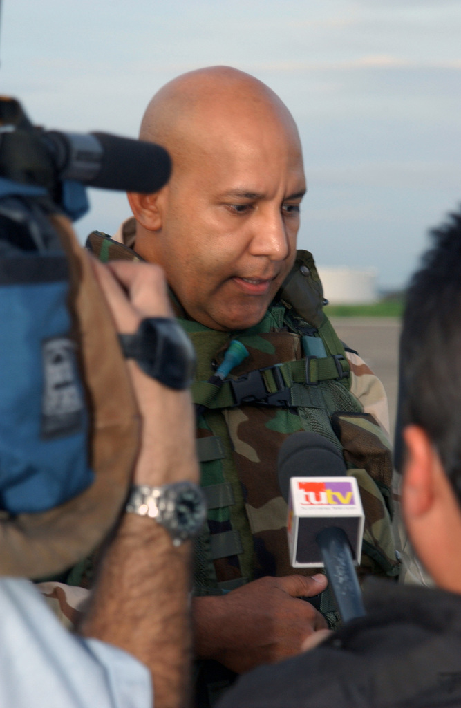 U.S. Army MAJ. Cosme Torres Sabater, Executive Officer, 346th Transportation Battalion, 65th Regional Support Command, Puerto Rico Army National Guard (PRANG), is interviewed by the local press at Roosevelt Roads Naval Air Station, Puerto Rico, on April 22, 2003, about his units impending deployment in support of Operation Iraqi Freedom. (U.S. Army photo by Marcos Orengo) (Released)