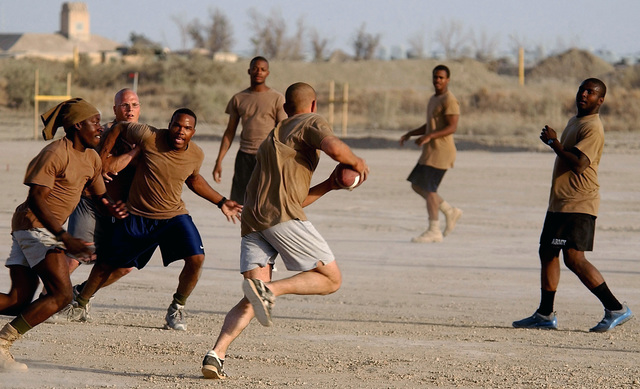 US Army (USA) members of 63rd Signal Battalion (SIG BN), Fort Gordon, Georgia (GA), play a game of touch football at Tallil Air Base (AB), Iraq, during Operation IRAQI FREEDOM