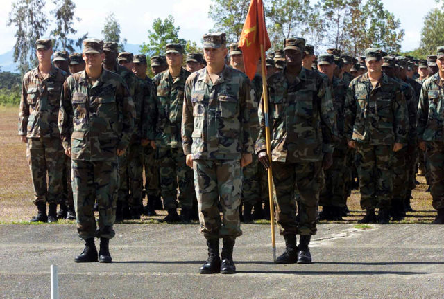 The US Army's (USA) Charlie Battery, in a joint effort with the US Marine Corps (USMC) 2nd Battalion, 11th Field Artillery Regiment, participates in the opening ceremony for Exercise BALIKATAN 2003