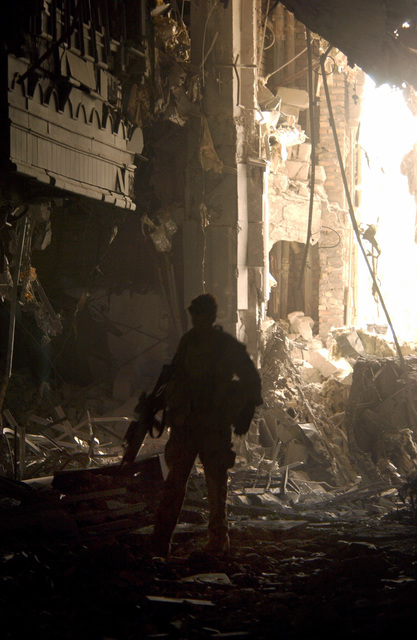 A Member of a Combat Control Team (CCT) walks through the rubble at one of Sadaam Hussein's palaces. The Combat Control Team (CCT) is currently deployed at the Baghdad International Airport (BIAP) in support of Operation IRAQI FREEDOM