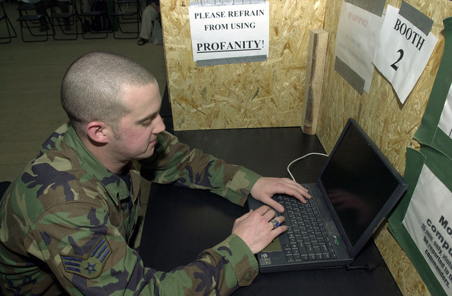 US Air Force (USAF) SENIOR Airmen (SRA) Justin Dixon, Communications Computer Controller, 458th Air Expeditionary Group (AEG), connects a desktop computer for the new cyber cafe setup at the Moral Welfare and Recreation (MWR) tent at Mihail Kogalniceanu Air Base (AB), Romania