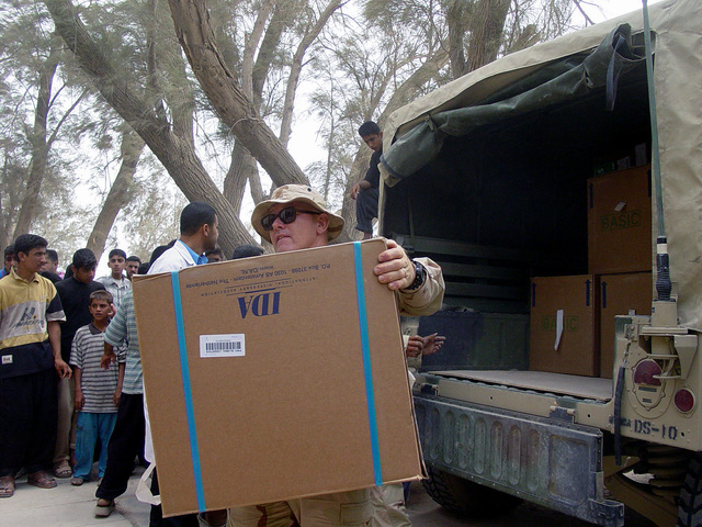 US Marine Corps (USMC) personnel assigned to the 3rd Civil Affairs Group offloads medical supplies donated to the Hospital at Umm Qasr, Iraq, during Operation IRAQI FREEDOM