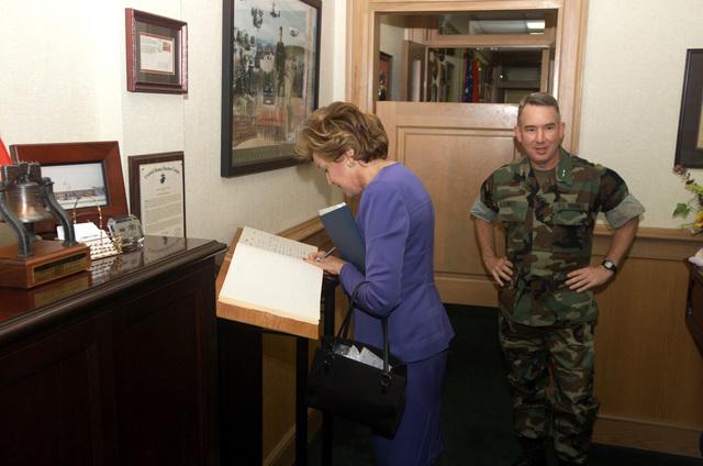 US Senator for North Carolina, Elizabeth Dole, Republican, signs the guest roster aboard Marine Corps Base (MCB) Camp Lejeune, North Carolina, during an official visit