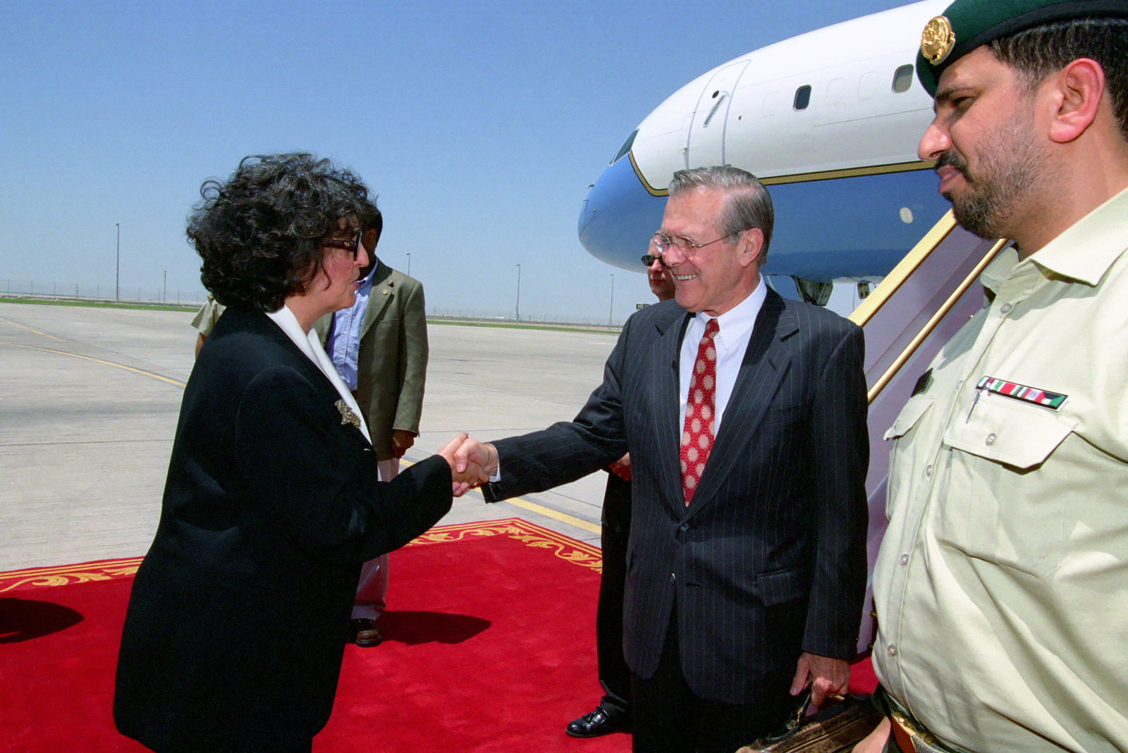 The Honorable Marcelle M. Wahba (left), U.S. Ambassador the the United Arab Emirates, greets the Honorable Donald H. Rumsfeld (center), U.S. Secretary of Defense, upon his arrival at Abu Dhabi International Airport, Abu Dhabi, United Arab Emirates, on April 27, 2003, for an official visit as part of his seven day tour of the region.  OSD Package No. A07D-00575 (DOD PHOTO by Helene C. Stikkel) (Released)