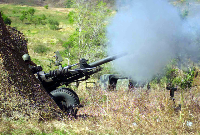 A US Army (USA) 2nd Battalion, 11th Field Artillery Regiment, M198 Towed Howitzer is concealed by camouflage netting during a live fire exercise, in support of Exercise BALIKATAN