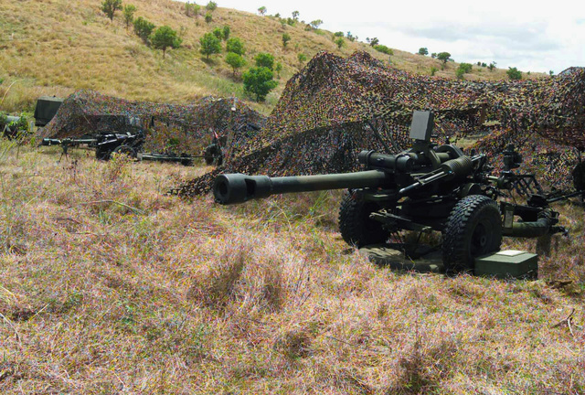 A US Army (USA) 2nd Battalion, 11th Field Artillery Regiment, M198 Towed Howitzer is concealed by camouflage netting in preparation for a live fire exercise during Exercise BALIKATAN